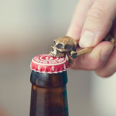 Small enough to carry in your pocket and awesome enough to show off proudly to the rest of the party, the Skull Bottle opener is hand cast from bronze and features a pop-topping skull on each end. Refreshingly cold beer not included. Art Et Design, Little Presents, Gothic House, Skull And Bones, Skull Art, Cool Gadgets, Sugar Skull, Cool Stuff, Stuff To Buy