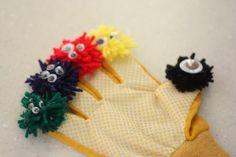 monster finger puppets = yarn + google eyes + glove