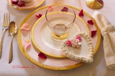 What's more romantic than candlelight and roses - a tablescape filled with both for Valentines