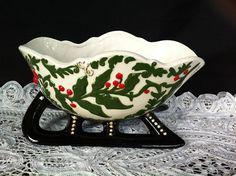 A Ceramic/Porcelain Sleigh Planter Vase With Holly Design
