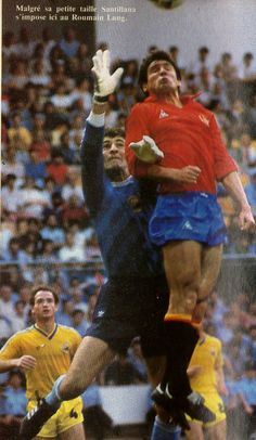 Romania 1 Spain 1 in 1984 in St Etienne. Romania keeper Siliviu Lung jumps up with Carlos Santillana in Group B at Euro '84.