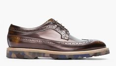 F/W 2013, Paul Smith did a great longwing, derby style brogue, complete with a camo rubber soul and bronze gradient effect