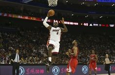 Maimi Heat 2012 China pre season games in Shanghai China Oct 14th 2012- LeBron James goes for the open court dunk. He is getting ready for another run at an NBA championship title.