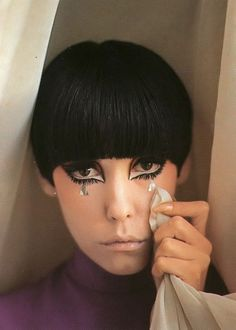 Peggy Moffitt was a well-known high fashion model in the 1960s, recognized for her asymmetrical haircut and heavy Kabuki-like makeup style. She played muse to Rudi Gernreich and made international headlines in his designs thanks to photographs by her husband William Claxton.