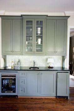 A bar area provides additional cabinet storage plus a mini fridge.