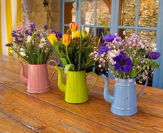 Flower pots made out of watering cans - cute