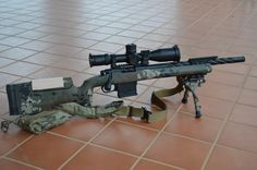 .308 caliber rifle with scope.