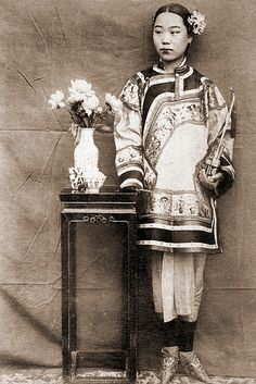 Chinese Beauty, Shandong, China, ca. 1900  This might be a prostitute judging from her look. When photography was first introduced to China, many prostitutes had their photos taken, probably for self promoting- Nan Luan