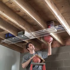 24 Clever Storage Ideas for Hard-to-Store Stuff Try Attic-Decking Panels To maximize the overhead garage storage space above garage rafters, instal Diy Garage Storage, Cord Storage, Basement Storage, Storage Hacks, Garage Organization, Built In Storage, Storage Shelves, Storage Ideas, Storage Solutions
