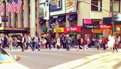 Bustling crowds crossing at 34th and 7th (Fashion Avenue).