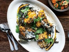 Whole cauliflower is quartered and roasted with paprika, turmeric, and jalapeño in this wintry side dish.