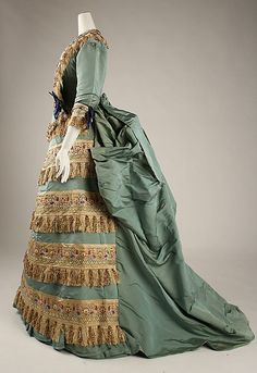 "Dress with Day Bodice (alternate view), Charles Frederick Worth (French (born England), Bourne 1825–1895 Paris) for the House of Worth (French, 1858–1956): ca. 1872, silk. ""Worth rarely scrutinized or adapted forms from the East; in this unusual example, he has emulated Middle Eastern enamels. More often, he was an instrument of a Western taste that was projected globally via imperialism."""
