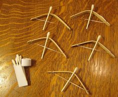 Rainy day craft that will keep your kids happy & entertained....Bow & arrow toy - made from Popsicle sticks, dental floss, Q-tips Almost Unschoolers: craft projects