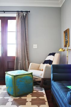 Simple, boxy, graphic floor poof!  Little Green Notebook: Room Tour: Fletcher's Nursery