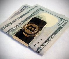 Bitcoin Money / The Bitcoin Money Clip from BTC Trinkets is a must-have item for those who own a ton of digital currency but have precious little to show for it in the physical realm. http://thegadgetflow.com/portfolio/bitcoin-money-clip/
