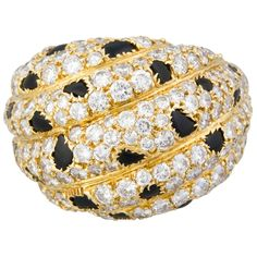 CARTIER Panthere Diamond Onyx and Gold Dome Ring | From a unique collection of vintage dome rings at http://www.1stdibs.com/jewelry/rings/dome-rings/ 16.5 K USD