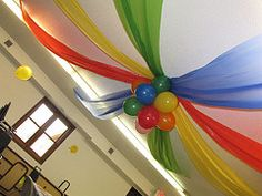 how to hang tablecloths as streamers. Perfect for Sesame Street Birthday!