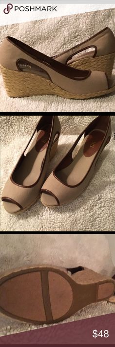 Women's size 10 open toe and side shoe. Taupe cloth uppers with brown manmade piping around open toe and side. They have a spring or summer for look for sure!! They have braided bottoms in natural color. New never worn, size 10. Chaps Shoes Wedges