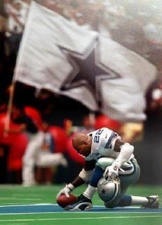 Dallas Cowboys running back Emmitt Smith (22) kneels on the star at the 50-yard line after scoring a touchdown just before the end of the first half of a game against the San Francisco 49ers on Sept. 24, 2000. Smith ran to the star after 49ers