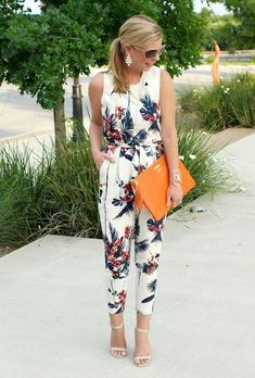 a tropical print sleeveless jumpsuit with cropped pants, nude heels and an orange clutch for a modern feel guest outfit summer 100 Stylish Wedding Guest Dresses That Are Sure To Impress Summer Wedding Outfits, Summer Wedding Guests, Summer Outfits, Cute Outfits, Ladies Wedding Outfits, Outfits For Weddings, Trendy Wedding, Jumpsuit Outfit, Floral Jumpsuit