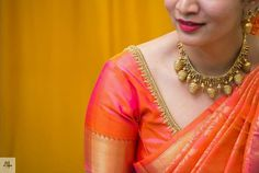 Orange and Gold. You can never go wrong with this combination! ❤ Also, look at that necklace! So whimsical! Wedding Saree Blouse Designs, Pattu Saree Blouse Designs, Blouse Designs Silk, Saree Blouse Patterns, Designer Blouse Patterns, Wedding Sarees, Dress Designs, Simple Blouse Designs, Indian Jewellery Design