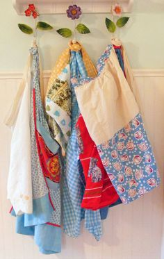 vintage aprons  in the front hallway, entrance to the kitchen