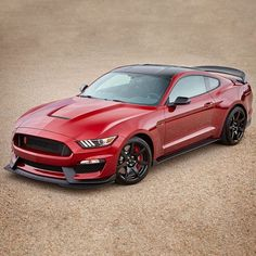 2017 GT350R in Ruby Red minus the racing strips with a black roof.