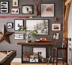 We're crazy about this room's rustic chic look. From the planked wall in versatile Mink SW 6004 to the wood decor, gallery wall and red accents, we're loving the cozy, ski lodge vibes.