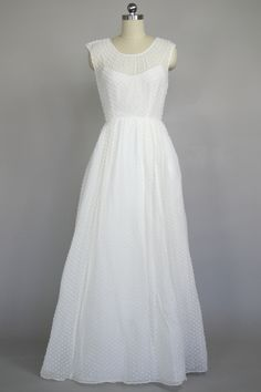 Sweet and feminine, this J. Crew gown is crafted from the sheerest silk and scattered with snips of cotton confetti.