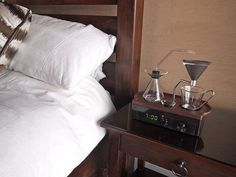 "DESIGN - An alarm clock that brews coffee : ""Barisieur"" by Joshua Renouf. London-based designer Joshua Renouf has created the ""Barisieur"", a charming alarm clock that is also a coffee-maker. Coffee Brewer, Coffee Cups, Coffee Maker, Coffee Coffee, Coffee Clock, Drip Coffee, Coffee Snobs, Coffee Time, Kitchen Timer"