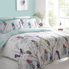 """""""Debenhams White 'Parrots' reversible bed linen- at Debenhams.com."""" I love how you can pull just about any color out of this bed covering and use it as a main color for the space and then also pull out accent colors too."""