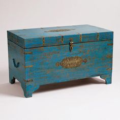 Ah ... do I pay most of a month's heating bill, or spend my $ on this WorldMarket.com: Blue Medallion Trunk?