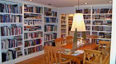 A dining room of bookshelves. I love this idea.