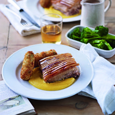 This meltingly tender pork belly recipe is accompanied by a creamy root veg purée and crispy wild garlic croquettes for a Sunday roast less ordinary.