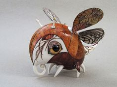 A duo of Ukrainian artists consisting of Anya Stasenko and Slava Leontyev creates tiny whimsical porcelain creatures that they paint with a wildly imaginative and creative array of painstakingly detailed and brilliantly colorful designs. Given the tiny size of these creatures (most measure anywhere from 4 to 40cm), one is a graphic artist and the other is a painting teacher.  Courtesy of Bored Panda