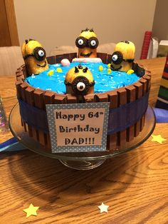 """Minion Pool Party"" birthday cake - minions were made with Twinkies, mini Oreos, black frosting and eye candy surrounded by Kit Kats.  Guaranteed to be a hit!!"