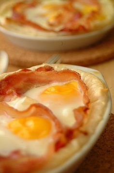 Bacon and Egg Pie...use puff pastry as the crust, spread wholegrain mustard on bottom of crust, sprinkle with parm cheese, then bacon, then the eggs and bake. YUMMMMM.