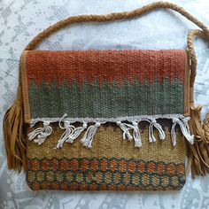 Beautiful indian shoulder bag made from suede and recycled rugs. Thick, braided suede strap and big suede fringe tassels on the sides. 10 x 13.5