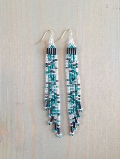 A cascade of seed beads in sparkling wintery hues of silver, teal, and black dangle from your ears with these hand-woven earrings. Fringe Earrings, Beaded Earrings, Drop Earrings, Beadwork, Beading, Christmas Tree Food, Beads And Wire, Cool Items, Wands