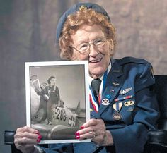 Betty Wall Strohfus, a WWII Women Airforce Service Pilot, holds a picture of herself when she was a WASP pilot, Sept. 27,2012, at Nellis Air Force Base, Nev. Strohfus was stationed at Las Vegas Army Air Field from 1943-44, and was one of 1,074 women who became certified WASP pilots during WWII. Las Vegas Army Air Field later was re-designated as Nellis AFB. The female pilots of the WASP freed up male pilots for combat services and duties during the WWII era.