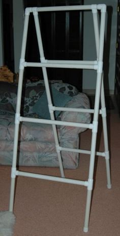 PVC pipe rack would work well for fabric cuts in the workroom / quilt show display