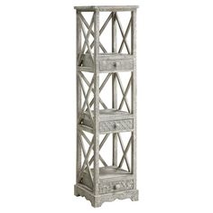 Hand-finished etagere with three shelves and lattice panel detail. Includes three drawers.  Product: Etagere Construction...
