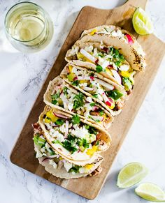 From an exotic salmon and pineapple combo to a sweet potato and guacamole filling, we've rounded up five vibrant and flavorful taco recipes that taste just as delicious as they look. 1....