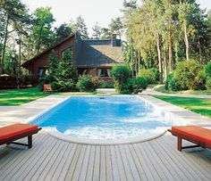 Very nice design with the house - Desjoyaux pools. Like the decking!!
