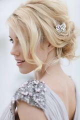 Pretty wedding hair with brooch accent.