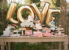 """Giant LOVE Balloons -  40"""" Inch Gold Mylar Balloons in Letters L-O-V-E  - Metallic Gold - Valentines Day Balloons, Wedding Decorations by ChrissyBPartyShop on Etsy https://www.etsy.com/listing/263111885/giant-love-balloons-40-inch-gold-mylar"""