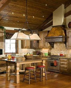 Small and cute rustic kitchen in this Montana guesthouse, built by Montana Build, Inc. Whitefish, Montana