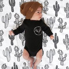 The sweetest little newborn babe! And can we talk about how cute this cactus blanket is?!
