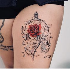 beauty and the beast rose in glass tattoo