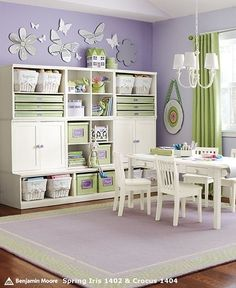 Could you ever have a playroom like this in your house?  Cute work table with organization system. Boys would LOVE this!